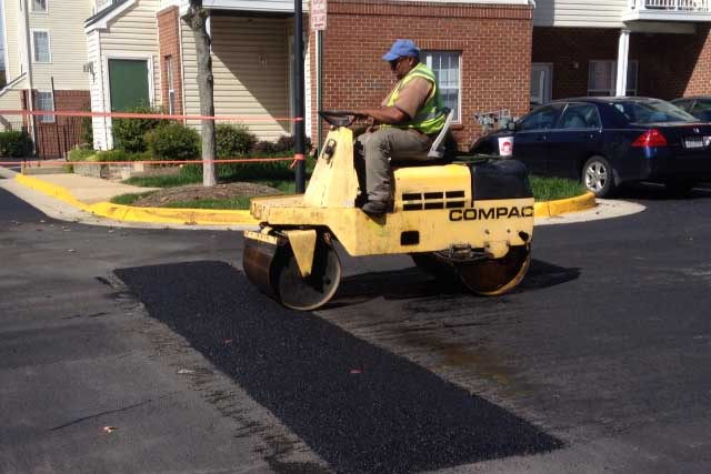 Picture of worker installing speed bump